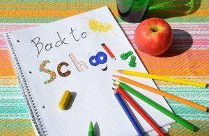 Imagem de caderno com mensagem De Volta À Escola